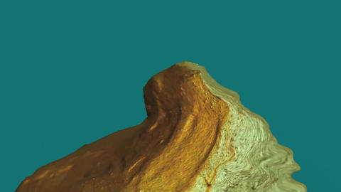 Melting hill of gold on blue green screen Filmmaterial