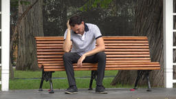 Sad Man With Loneliness Sitting In Park Live Action