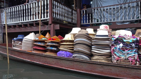 Boat with hats on floating market in Thailand Footage