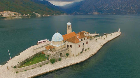 Aerial View of Sea, Mountains and Old Church on Island Footage