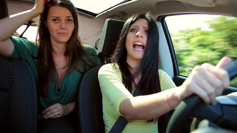 Beautiful women arguing fighting and crying in car while driving Footage