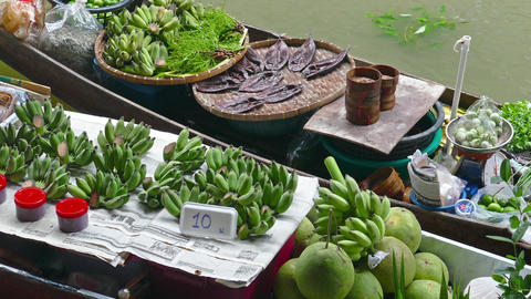 Boat with fruits and fish on floating market Footage
