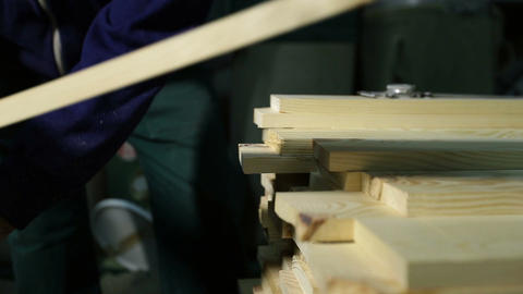 Carpenter working with electric planer machine Footage