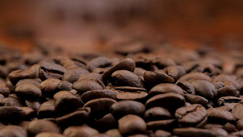 Coffee beans falling down in slow motion Footage