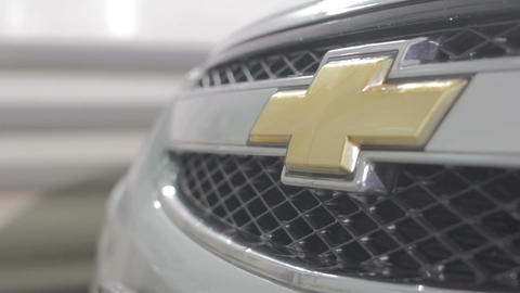 Just Washed Shevrollie Radiator Grid with Gold Emblem Closeup Footage