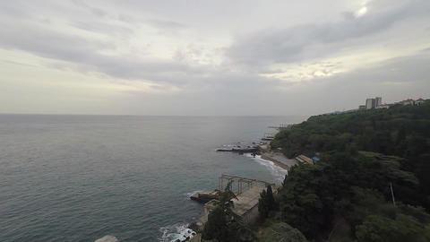 Aerial drone shot: Flying over tranquil sea with cloudy sky in the background Filmmaterial