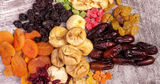 Mix of dried fruits on wooden background