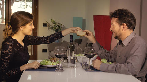 Couple in love holding hands during romantic dinner at home Live Action