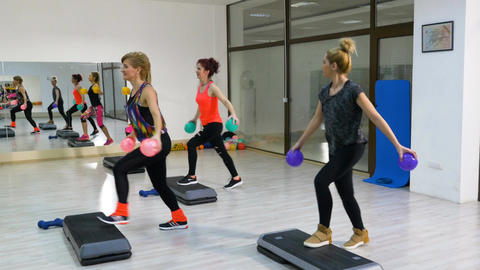 Girls doing Work out with stepper for arms and legs Footage