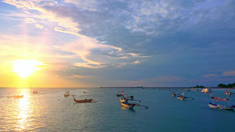 Spectacular seascape with many anchored outrigger fishing boats. Bali, Indonesia Footage