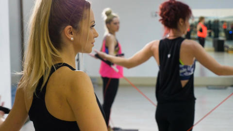 Young attractive women stretching in aerobics class Footage