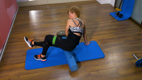 Woman doing spine exercise work out at the gym Footage