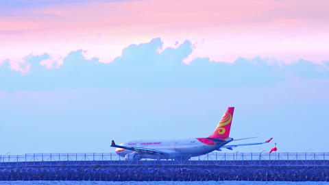 Airplane of Hong Kong Airlines moving along runway of Ngurah Rail airport. Bali Footage