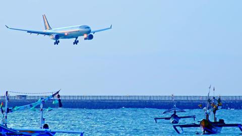Airplane of Garuda Indonesia descending in Ngurah Rai airport. Bali, Indonesia Footage