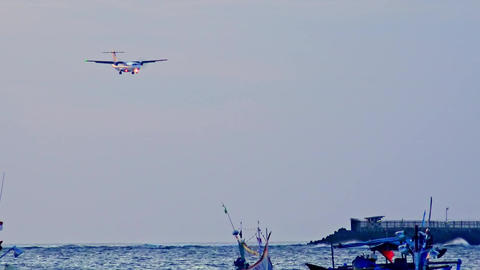 Plane landing on runway of Ngurah Rai international airport. Bali, Indonesia Footage