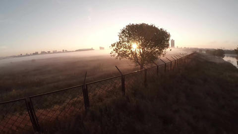 Scenic flight above the clouds towards the sun. Thick fog lying on fields, fores Footage