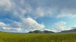 Green grass blowing in the wind with mountain range against timelapse stormy clo Animation