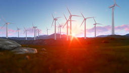 Wind turbine farm over green meadow, rays of light at sunrise Animation