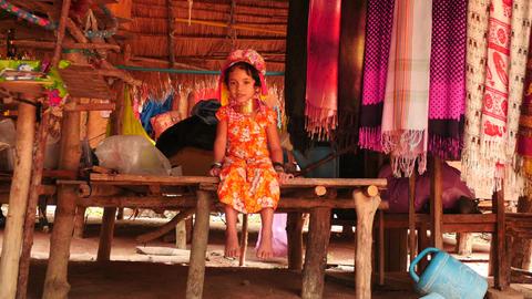 baby girl sitting in traditional dress of Karen long neck village of Thailand ne Footage