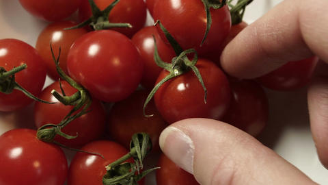 Taking Cherry Tomatoes From Bowl Closeup Footage