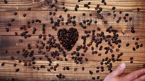 Hand is moving over coffee beans Footage