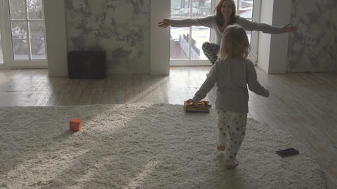 Child runs to mother and hugs Footage