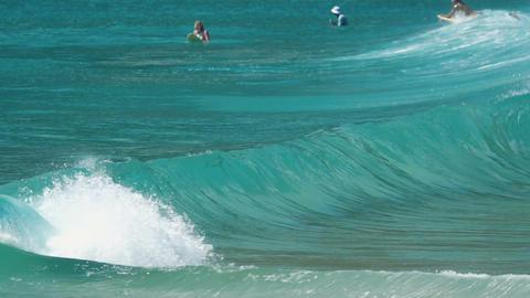Surfers floating on ocean waves Footage