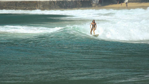 Attractive female surfer riding on wave Footage