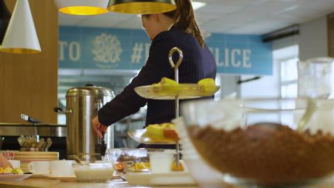 Wideshot Distribution in School Cafeteria Schoolgirl Pour Drink Footage