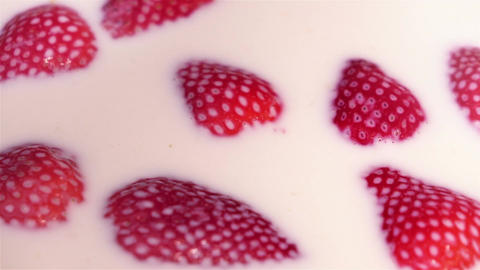 Video of strawberries falling into milk in real slow motion Footage