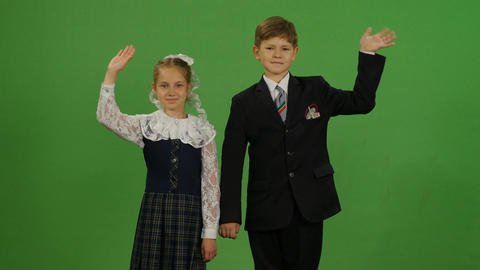 Closeup Schoolboy and Schoolgirl Wave Hand on Hromakey Footage