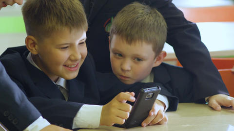 Closeup Schoolboy Show Mobile to Friend in School Cafeteria Footage