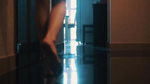 View of woman walk in bathroom in apartment. Legs. Floor. Walking Live Action