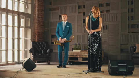 Jazz vocalist and saxophonist in blue suit perform on stage. Elegantly duet Footage