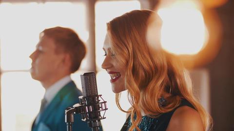 Jazz duet perform in restaurant. Vocalist. Saxophonist. Retro style. Spotlights Footage