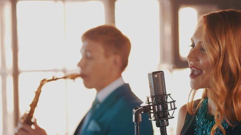 Jazz duet perform in restaurant. Vocalist. Saxophonist. Retro style. Musicians Footage