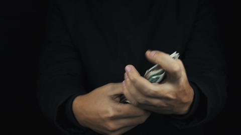 Male hand in long sleeve jacket count money bills and make hold forth gestures Footage