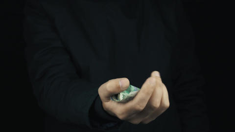 Male hand in long sleeve jacket rubbing fingers together, get money and count it Footage