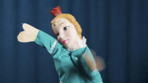 Princess hand puppet appears on scene and do hip hop movements, blue background Live Action