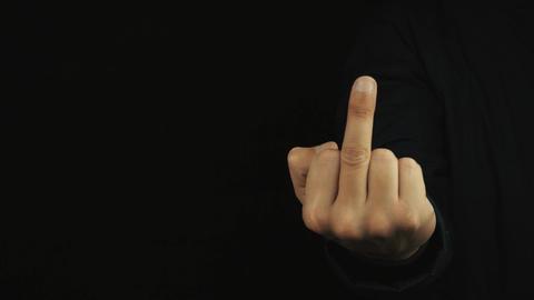 Male hand in long sleeve jacket making obscene flip off finger sign gesture Footage
