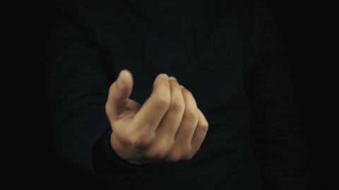 Male hand in long sleeve jacket make money sign gesture rubbing fingers together Live Action