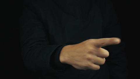 Male hand in long sleeve jacket making swipe gesture in air with finger Footage