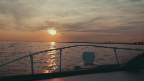 Boat slowly sail to summer beautiful sunset. Sea. Nature. Romantic evening Footage