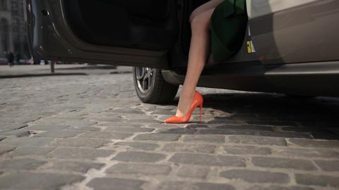 Slender lady legs in high heels getting out of car Footage