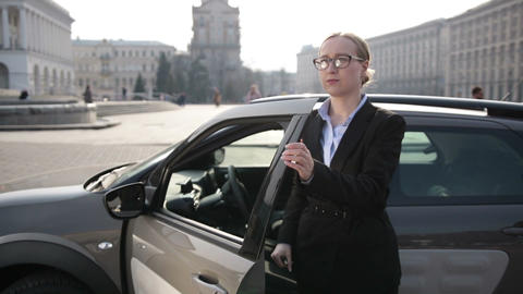 Determined business lady stepping out of car Live Action