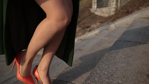 Sexy female legs in high heels climbing up stairs Footage