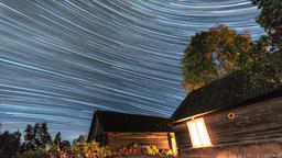 Star Trails. Night time-lapse over old village Footage