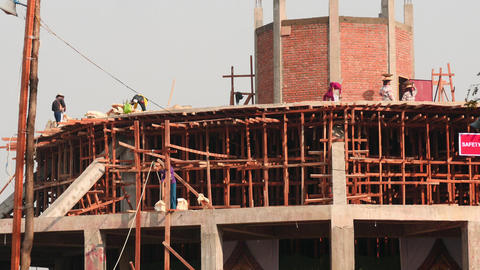 Workers build a new Pagoda in Myanmar, Filmed near Inle lake of Myanmar Footage