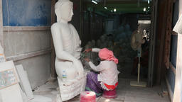 Man and Woman works with Buddha marble statue in Tampawaddy Quarter of Mandalay Footage