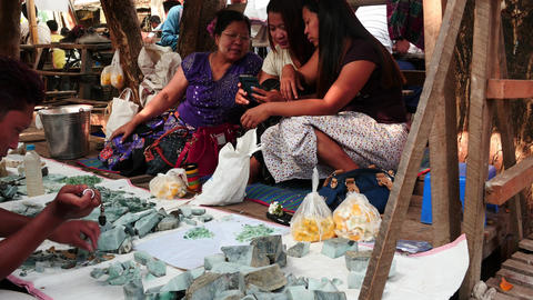 Jade trade and machine polishing in Mandalay of Myanmar - 2 videos sequence Footage